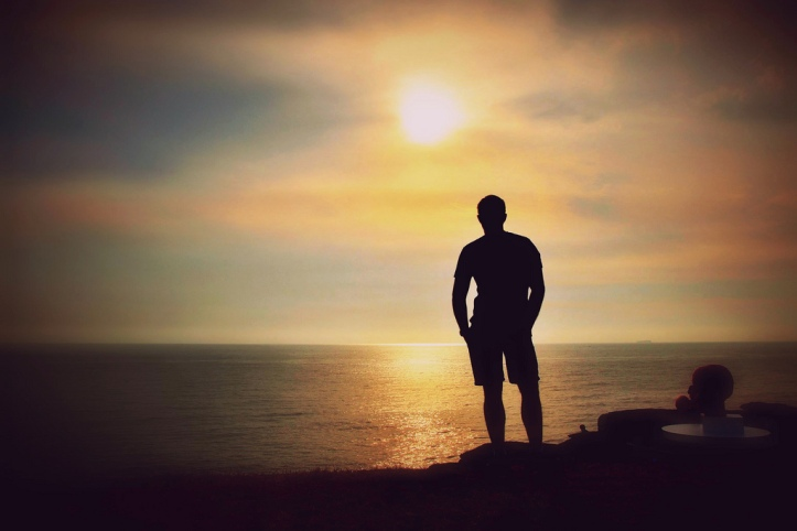 man-staring-into-sunset